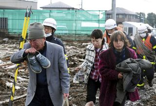 Japan second tsunami,japan volcano,the Homeless people hide his face from crying